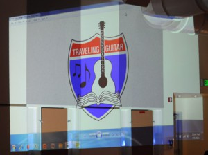 The TGF logo projected against the wall at Frank Del Olmo Elementary school.