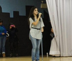 Pop singer Tiffany Araya performs for the students.